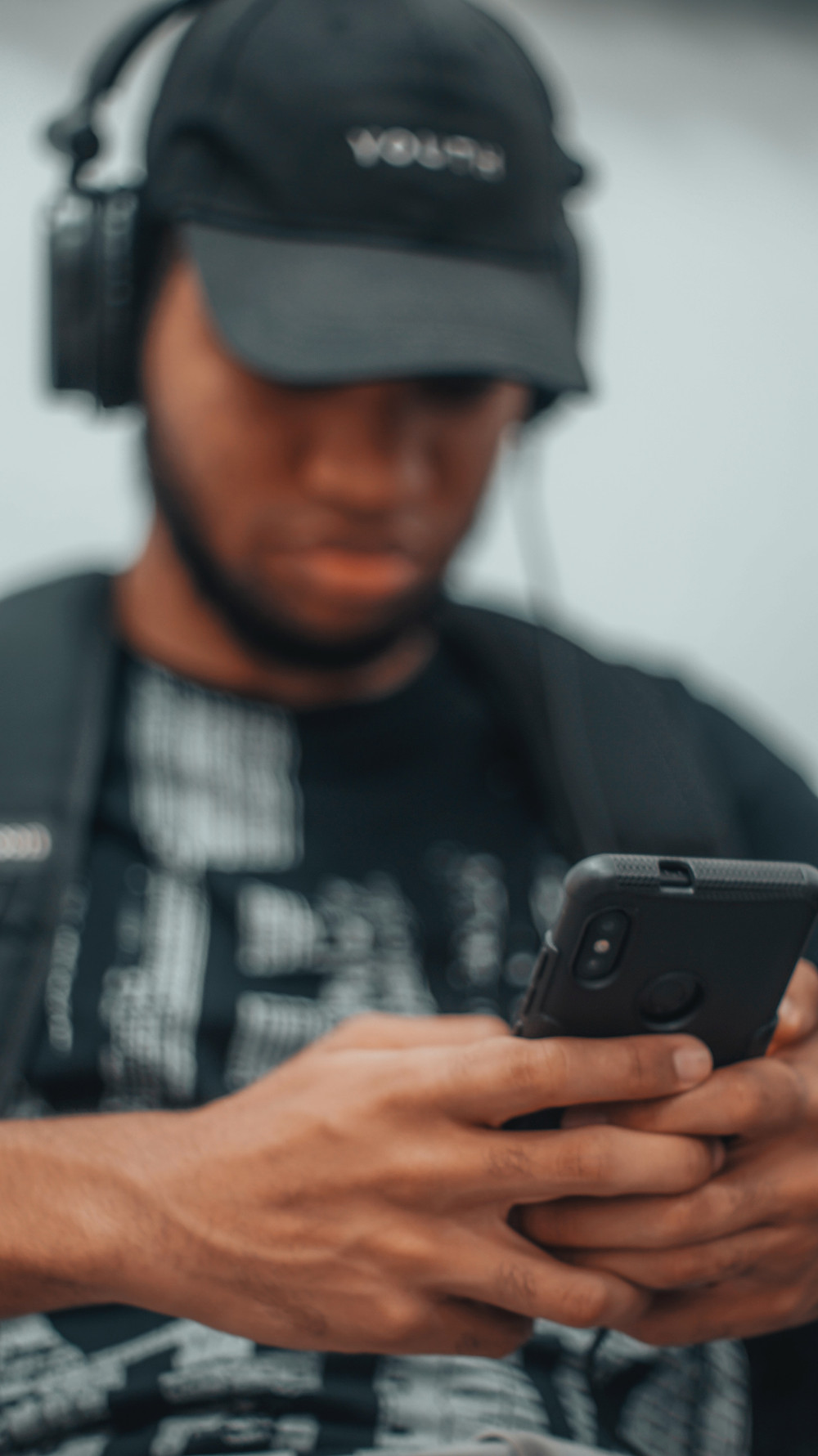 A young man using his phone