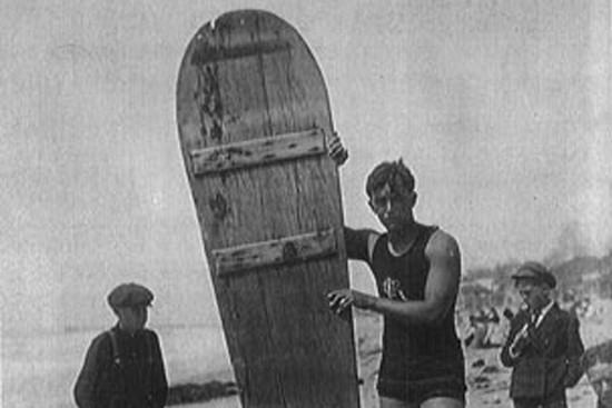 Jack London with a surfboard in Hawaii