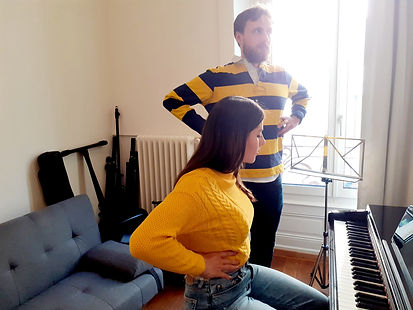 Vocal coaching both hands on ribs.jpg