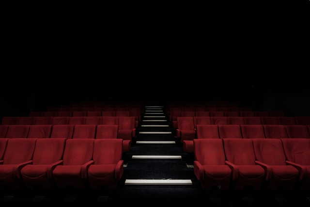 The empty seats of a dimly lit cinema
