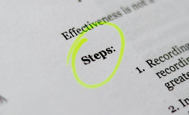 """A close up shot of text on a page. Highlighted is the word """"steps"""""""