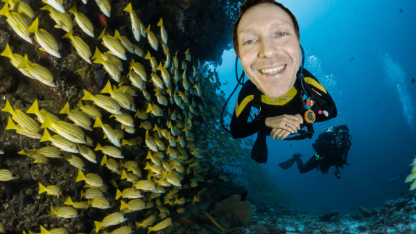 Martin Whiskin deep sea diving with a school of fish
