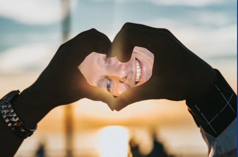 Two hands make a heart shape with Martin Whiskin's face in the middle