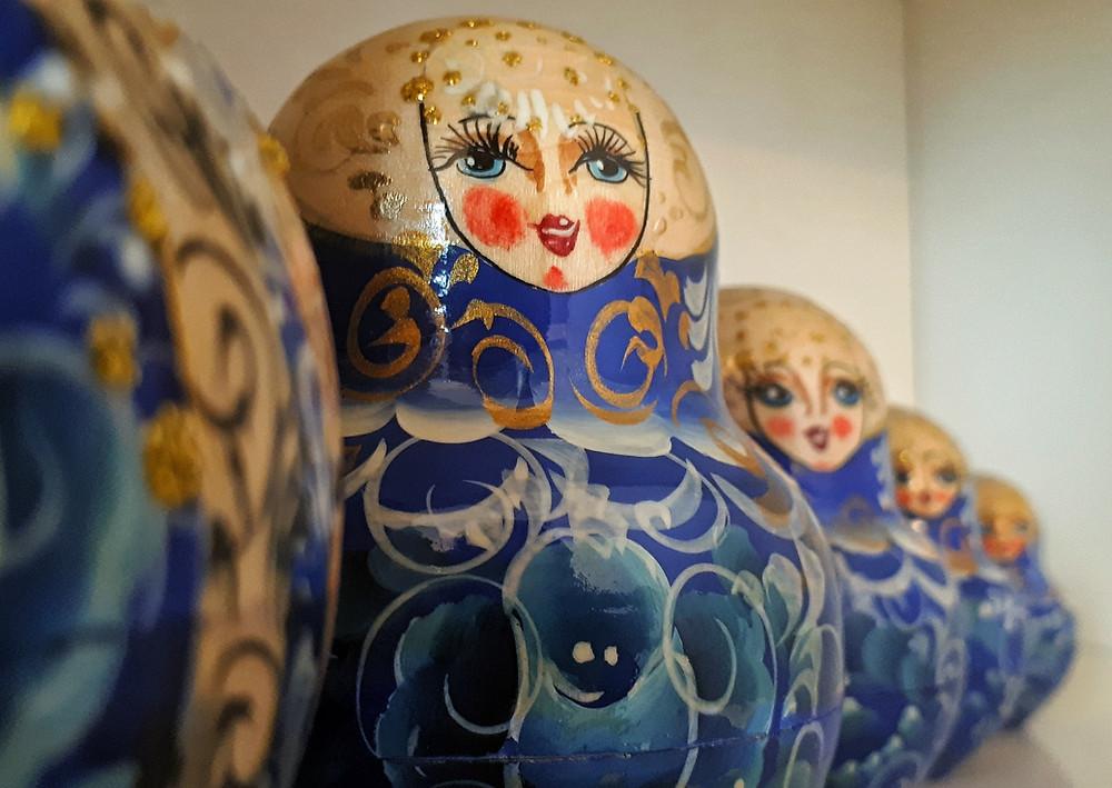 Blue Russian dolls on a living room shelf