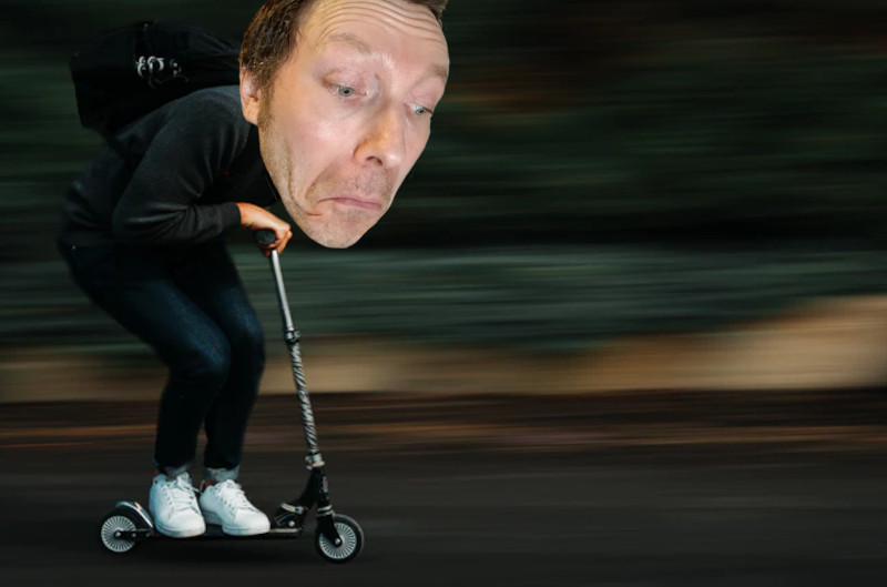 Martin Whiskin rides a scooter at speed