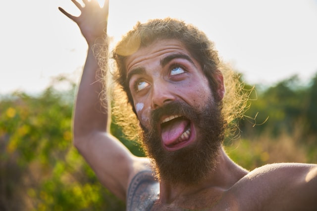 A bearded man pulling a funny face to come across as a bit crazy