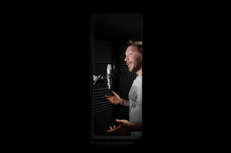 Voice over artist Martin Whiskin in a vocal booth