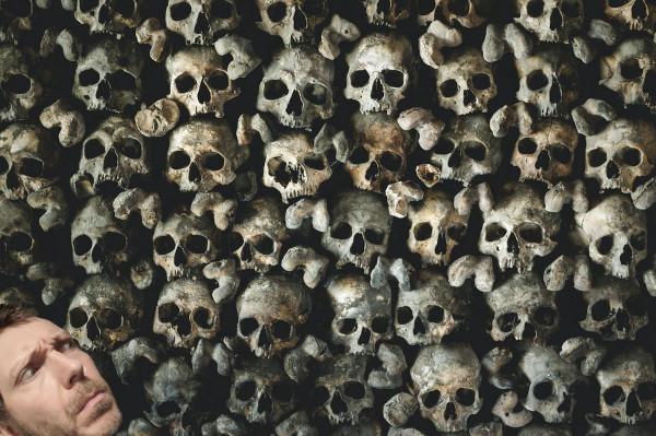 Voiceover artist Martin Whiskin in amongst some skulls