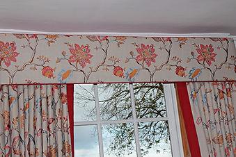 Interior Design of bedroom in Hampshire, including bespoke curtain, pelmet, designer fabric, corresponding colours, and beautiful design