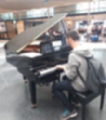 Edward Mewburn playing piano