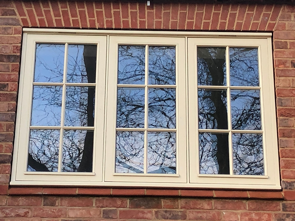 High Performance Traditional Flush Casement Window finished in 'String'