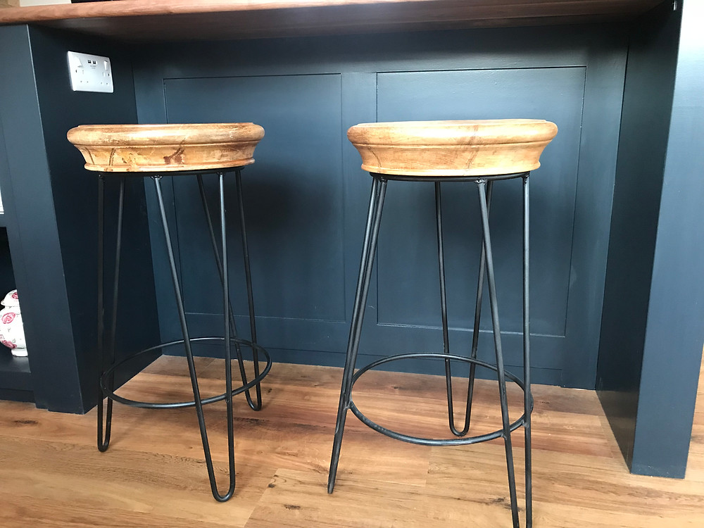 Two hairpin leg stools sit elegantly underneath a breakfast bar in the Barn Conversion kitchen.