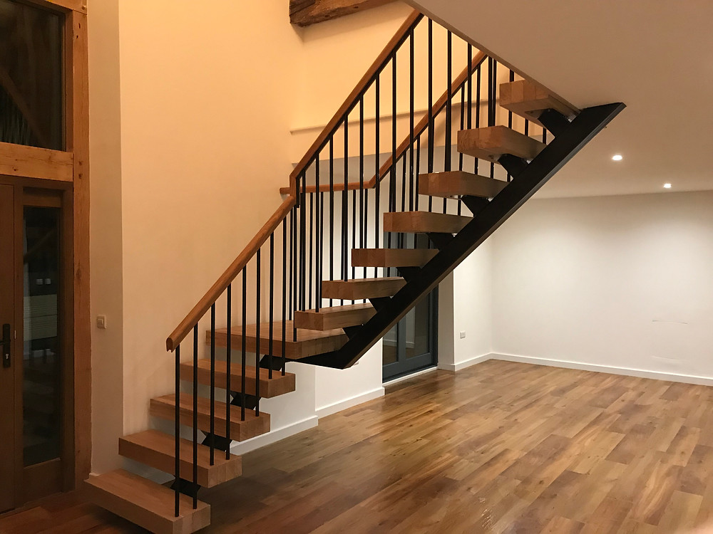 Modern industrial staircase with solid oak risers and black painted spine and spindles