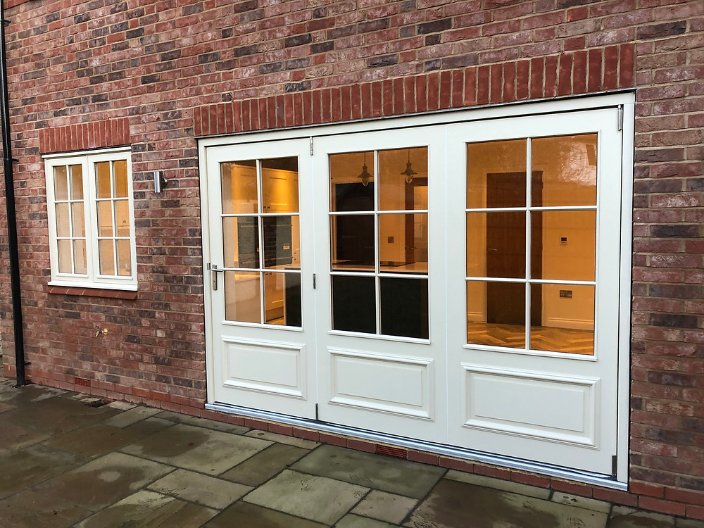 Painted Hardwood Bi Folding Doors with Raised and Fielded Panels with Bolection Mould and Duplex Bar