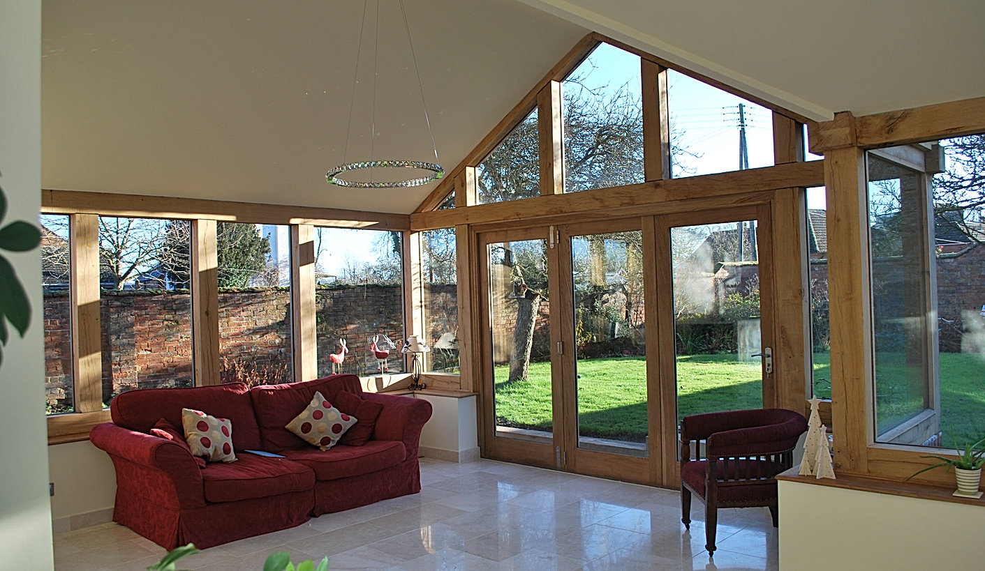 Oak Framed Orangery Sunroom with Bi Folding Doors