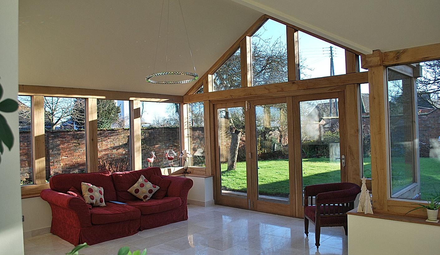 Oak Framed Orangery Sunroom with Bi Folding Doors