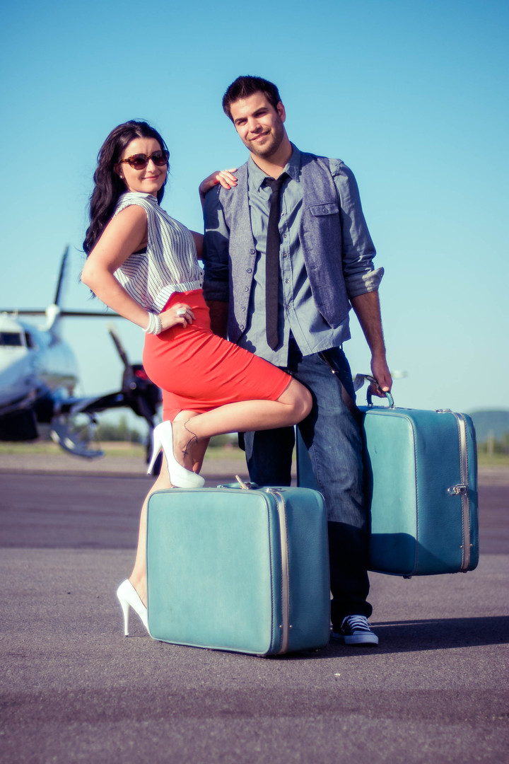 Couple and Suitcases