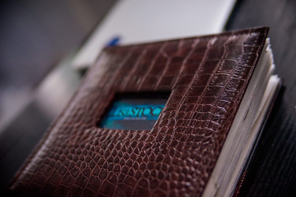 photobook exterior - Lisa Stock - Business card - fake brown leather snake scale album