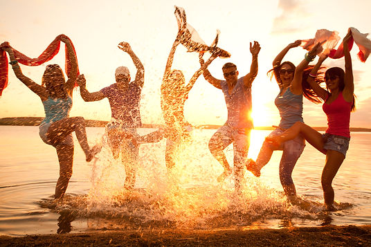 Large group of young people enjoying a beach party.jpg
