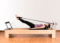 working-pilates-on-reformer-bed-48691933