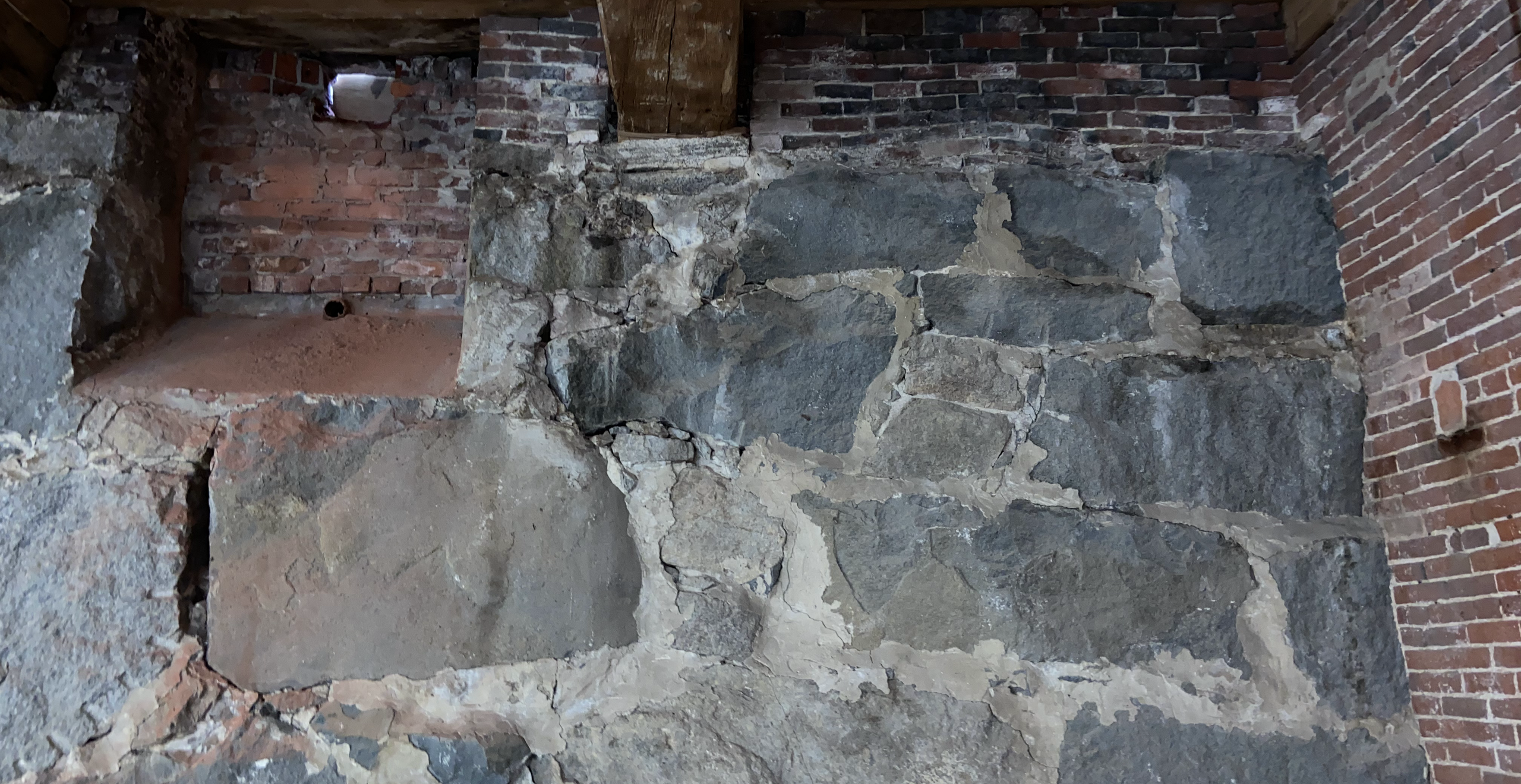 Existing stone wall to remain in gallery space