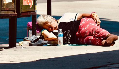 homeless lady sleeping on the street