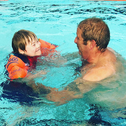 Having fun learning to swim with Dad