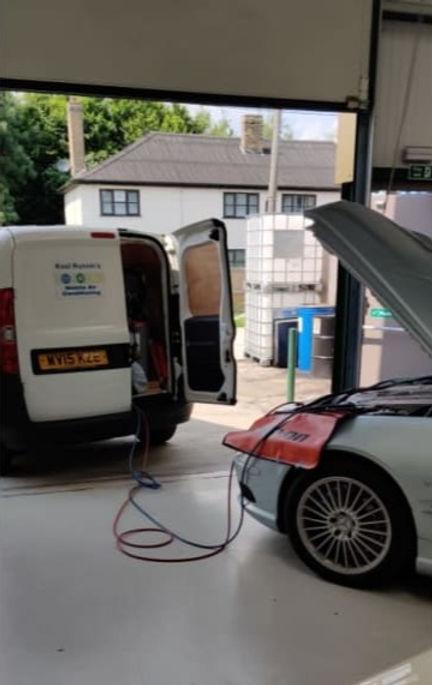 Kool Runnins fixing car in a garage.jpg