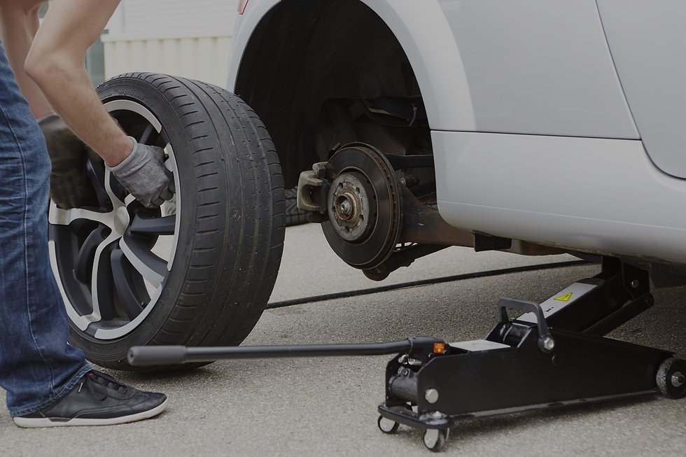 car tyre being replaced on roadside