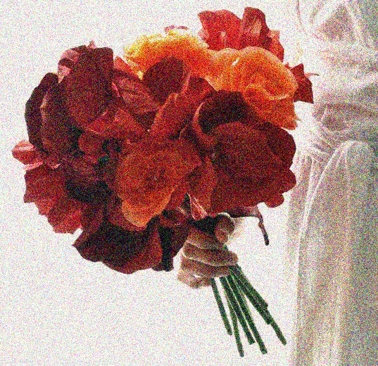 She proposed with a poppy bouquet in her hand.