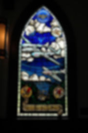 Stained glass of planes flying to remember veterans