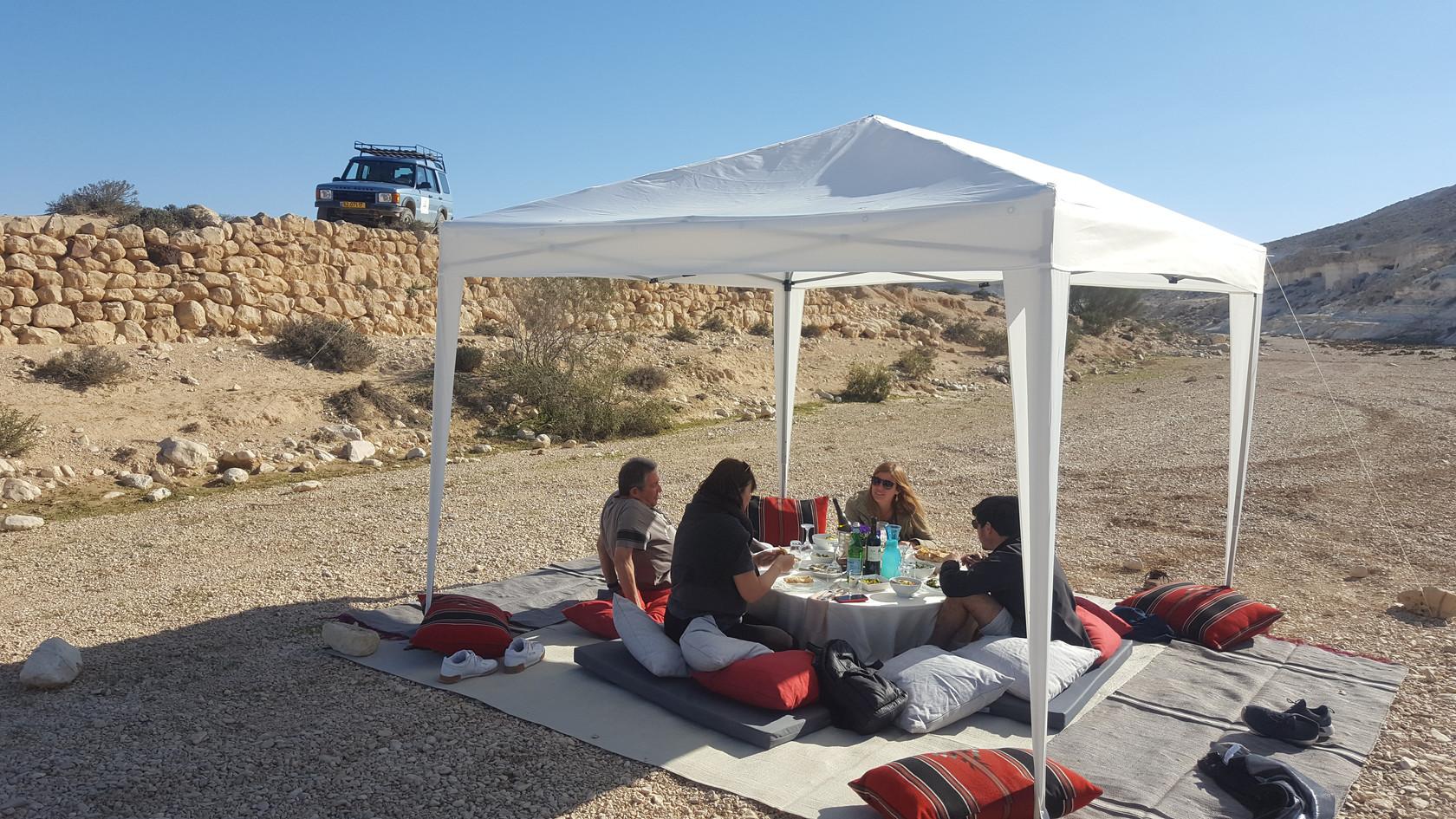 Family outdoor meal in the Negev Desert