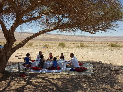 Family Bedouin style lunch in the Israeli Negev Desert