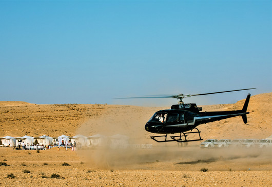 Pop up glamour camping hotel & Helicopter tours in the Israeli desert