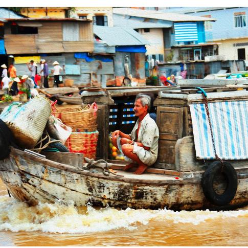 Man on Floating Boat