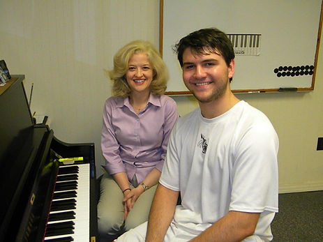 Teacher and piano student