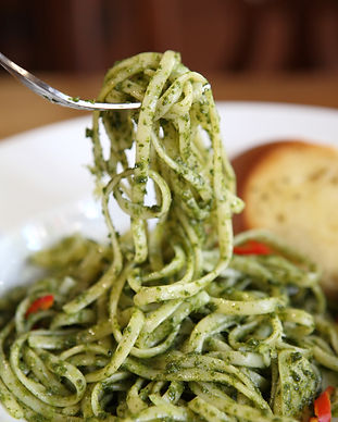 spaghetti with pesto sauce on wood backg