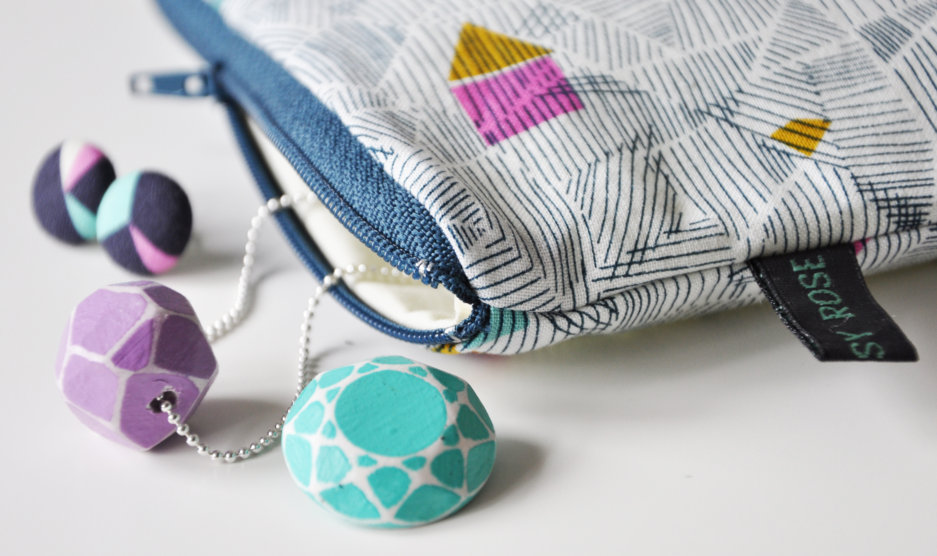 FAB geometric mini studs and zip pouch