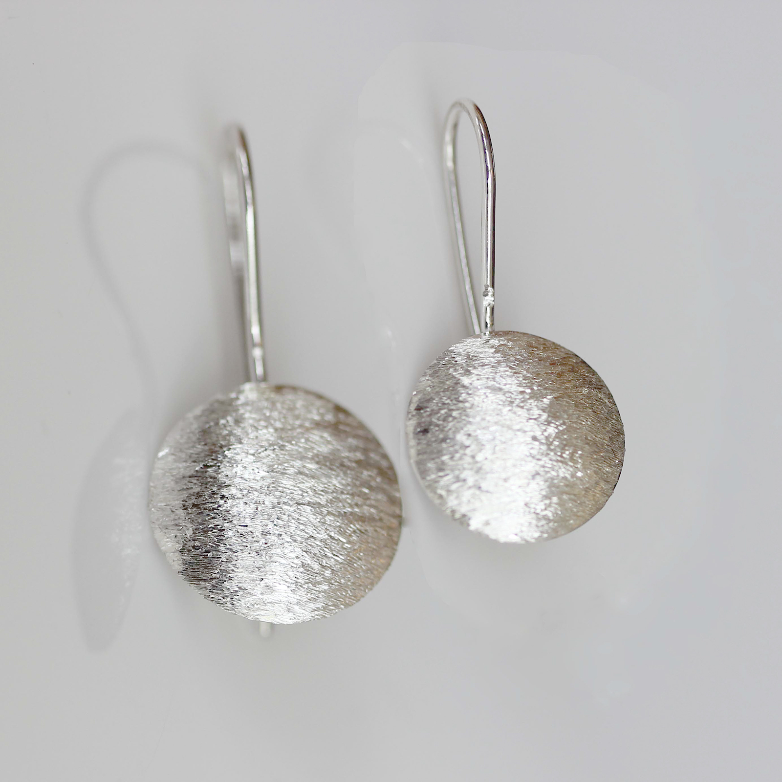 Textured convex earrings