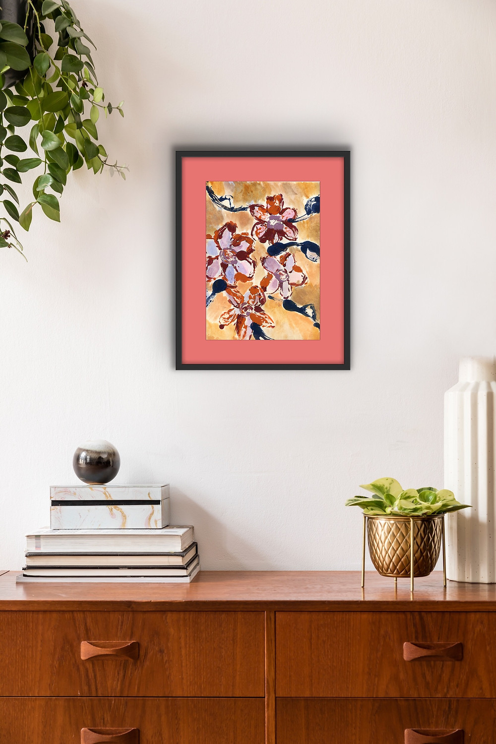 Spanish wall art with a peach matte and black frame.