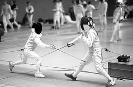 Girl and Boy fencing Foil at a tournamen