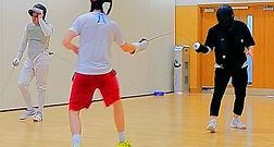 Fencers receiving a lesson from coach