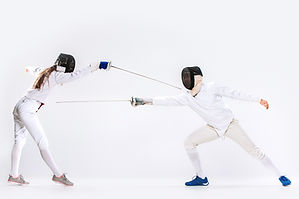 The woman and man wearing fencing suit p