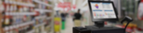 A point of sale computer with Striven software, shown in front of a blurry hardware store