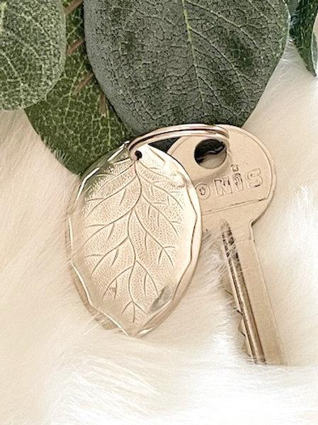 Porte clefs ovale petit modele en Argent à graver selon votre choix