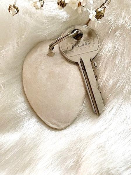 Porte clefs ovale moyen modele en Argent à graver selon votre choix