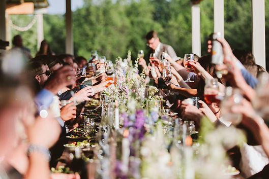 event venue with guests toasting at long banquet table