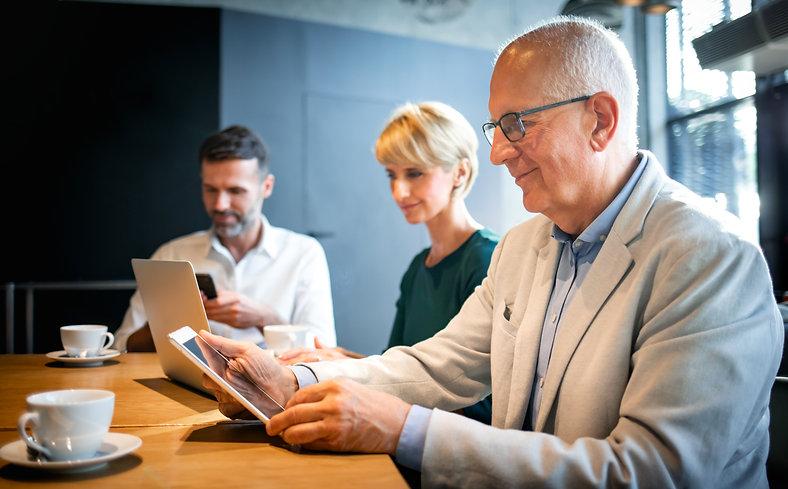 businessman-using-digital-tablet-during-