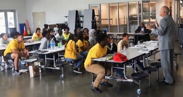 New Orleans Kids listening to speaker during EAS leadership class