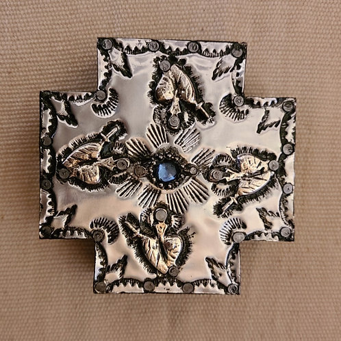 526 Repousse Metal Cross with milagros and blue stone